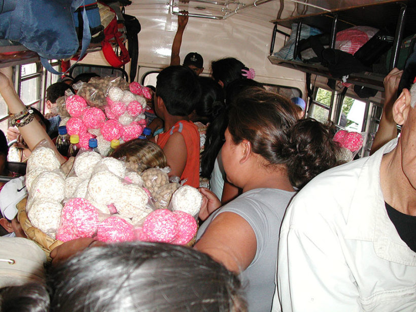 Crowded buses in Guatemala.