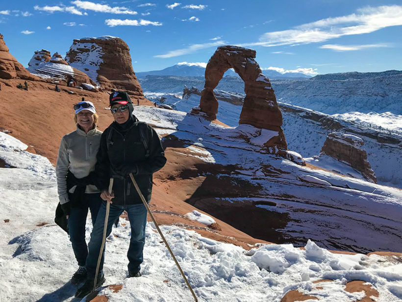 Weasel & Grasshopper posing in Utah's Arches - Delicate Arch.