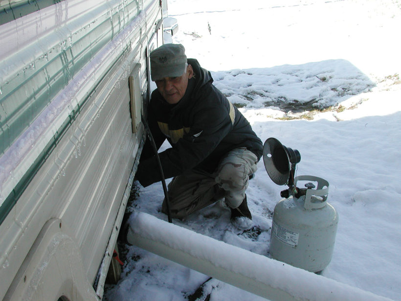 Weasel tries to thaw the pipes to our black water tank.