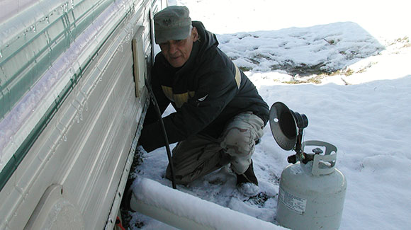 Weasel tries to thaw the pipes to our black water tank on our RV.